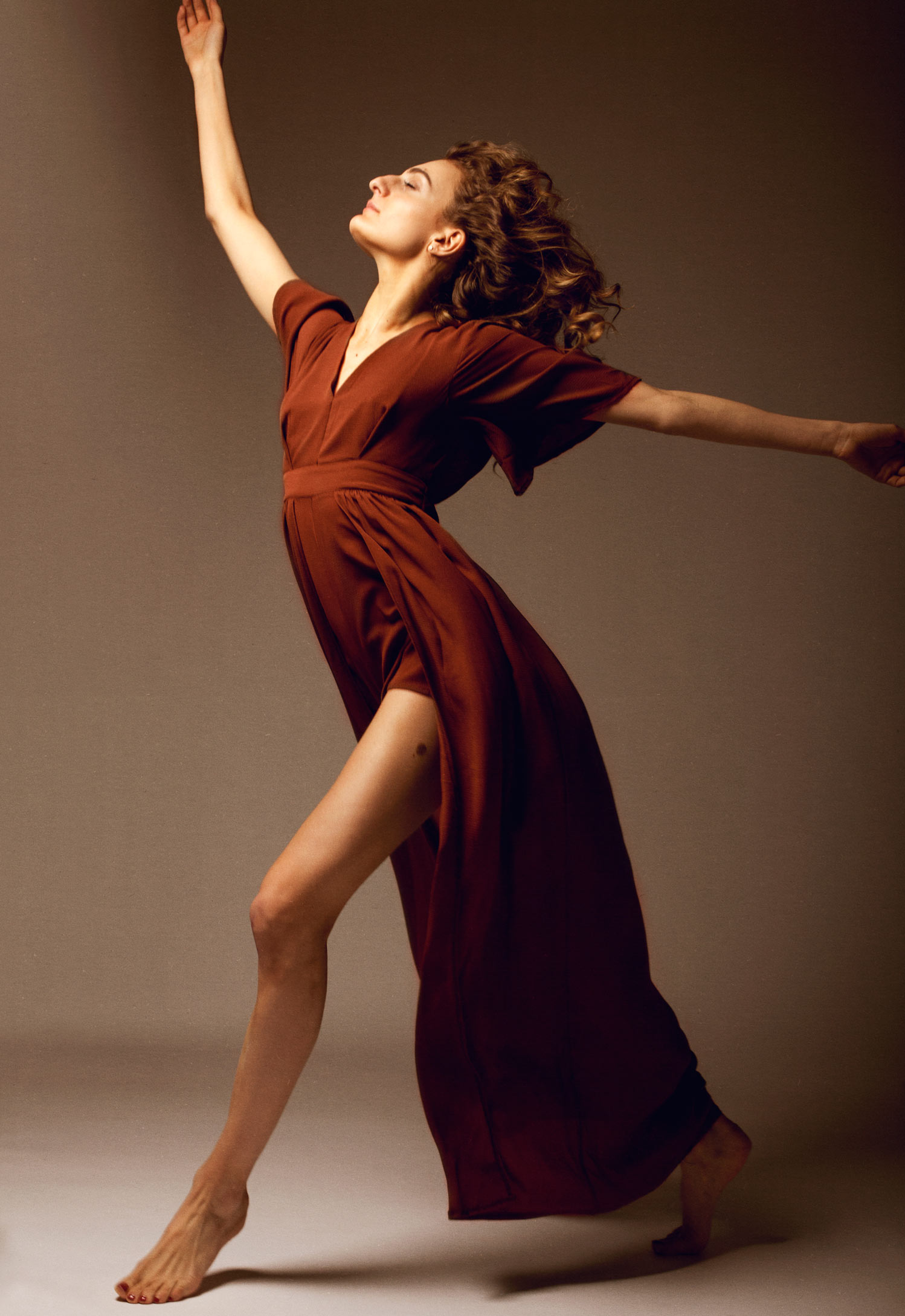 Full-length studio photography of gabriella papadakis dancing in a wispy dress