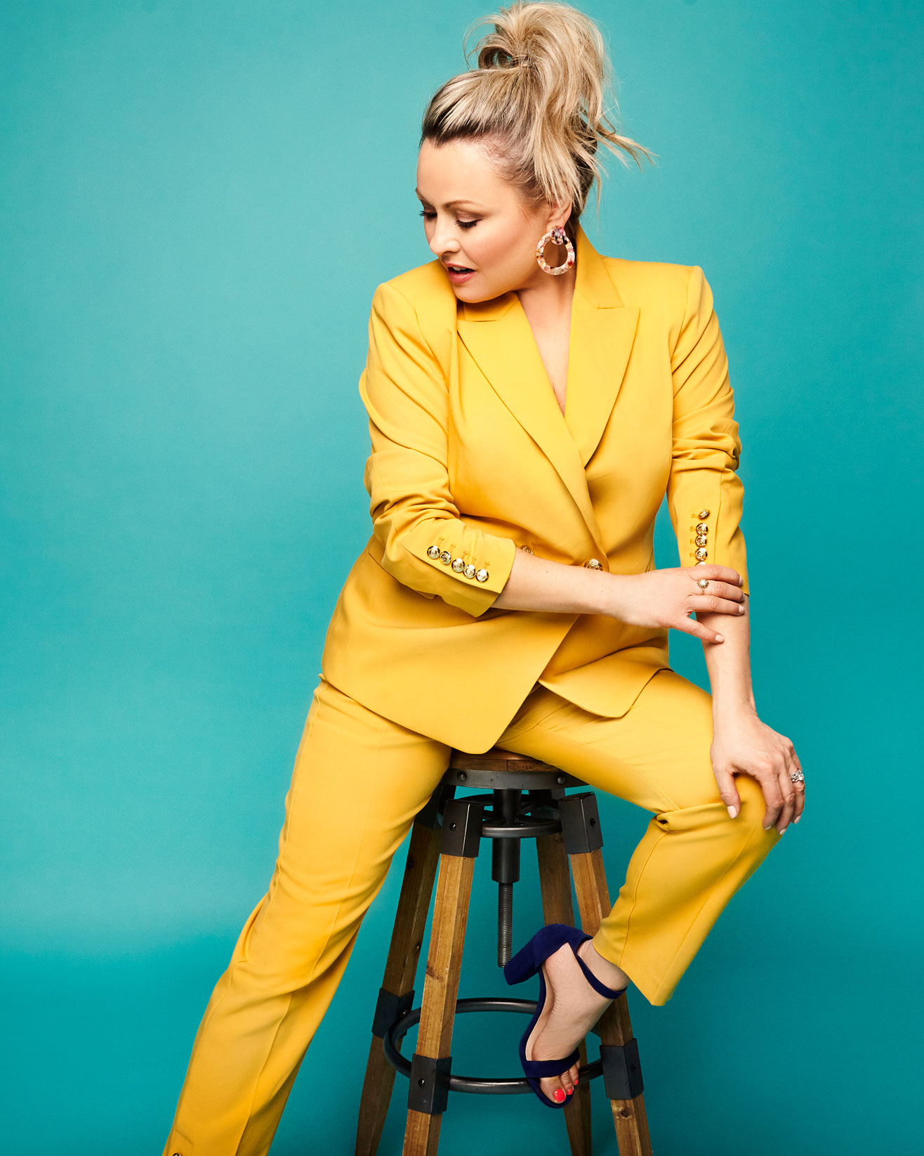 Celebrity and celebrity photographer in Montreal. Portrait of mitsou gelinas in a yellow suit. Photographed by Dariane Sanche.