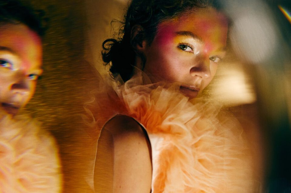 Artistic photo portrait using a prism to create special effects on photos.